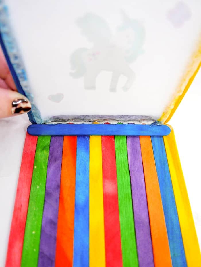 Hot glue the bottom of each frame onto the craft sticks