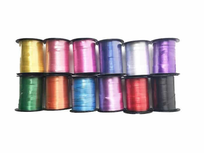 Rainbow Curling Ribbon | Rainbow Craft Supplies | Colorful Kids Crafts | All the craft supplies you need to keep you and your kids occupied for hours and hours. | Rainbow Popsicles, Rainbow Cupcake Wrappers, Rainbow Pom poms and more | www.madewithhappy.com
