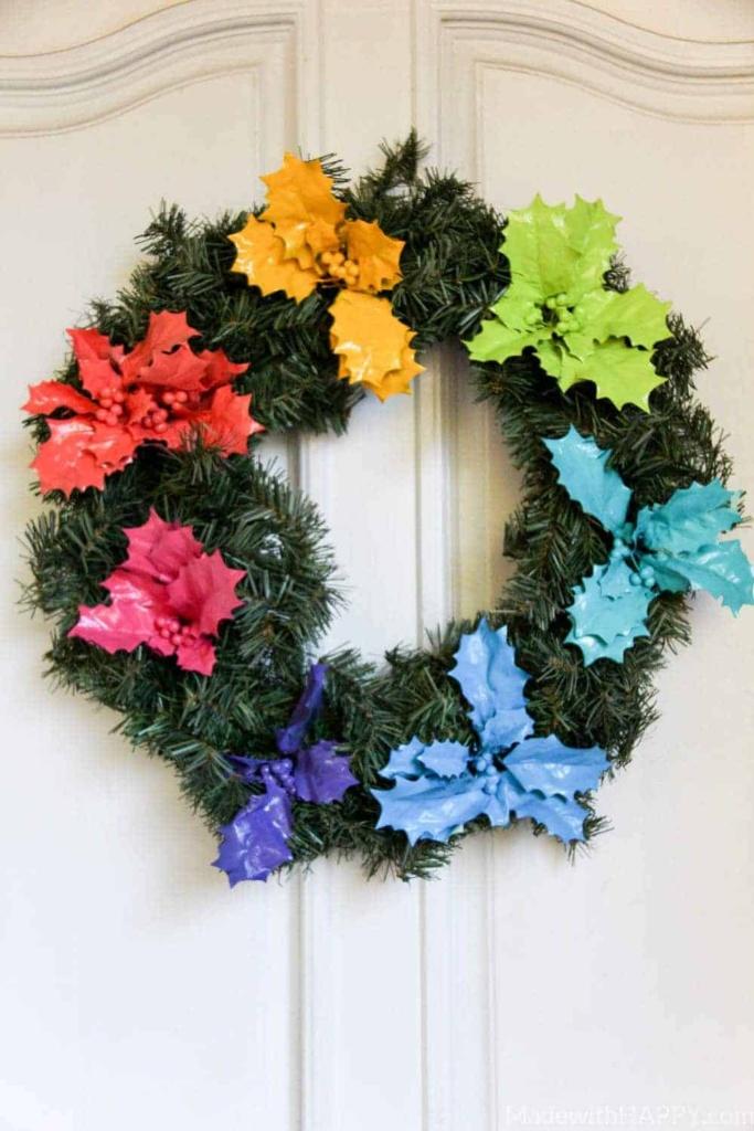 Rainbow Holly Wreath   Rainbow Wreaths   Christmas gone rainbow   Bright colorful Christmas   DIY Christmas Wreath   www.madewithhappy.com