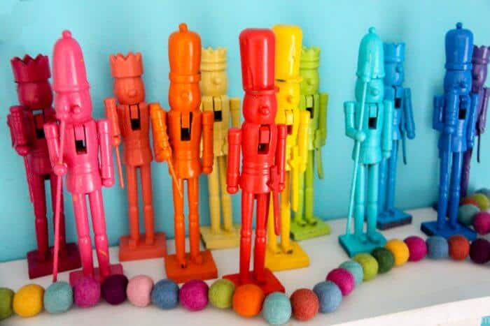 Rainbow Painted Dollar Store Nutcrackers Set on a mantle and displayed for Christmas