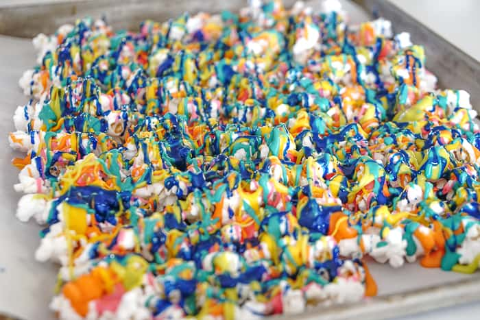 There is nothing sweeter than turning up the color on your popcorn snack with this super fun rainbow popcorn.  Rainbow snacks for St. Patrick's Day.  Rainbow food ideas