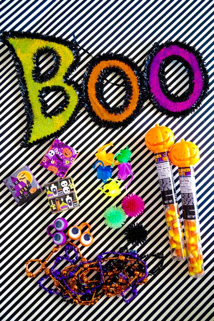 Colorful Boo door sign plus halloween party favors.