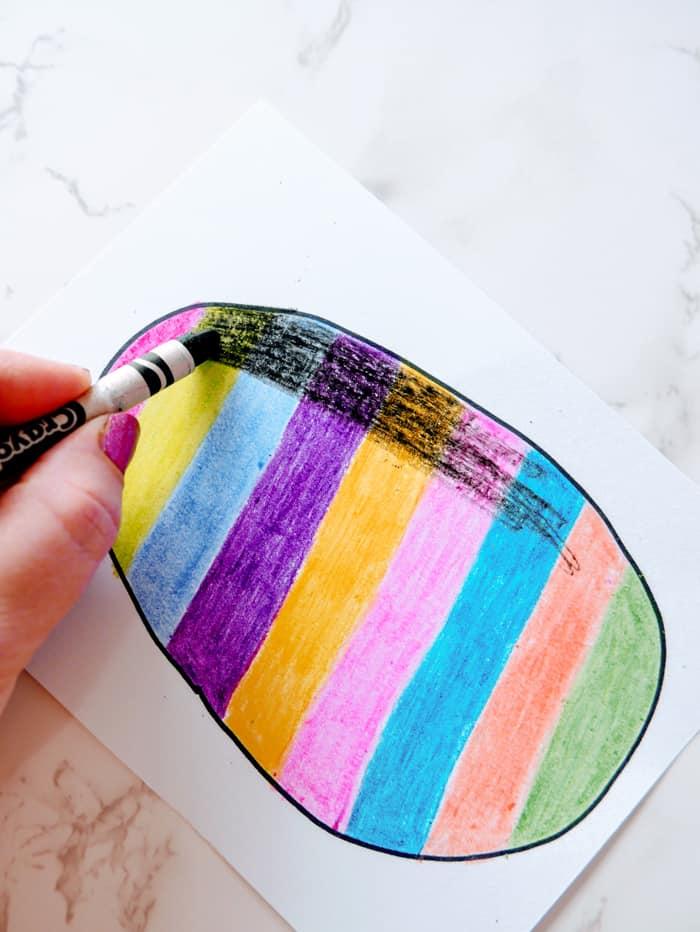 color black crayon over egg