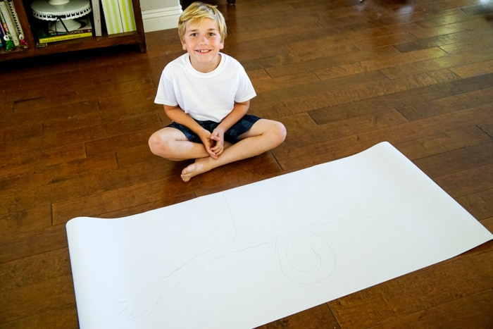 Kid creating a life size self portrait