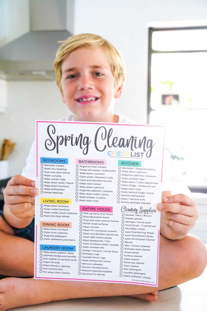 Spring Cleaning Checklist - Boy holding