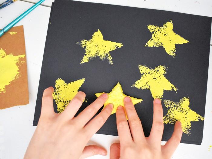 kid stamping paper