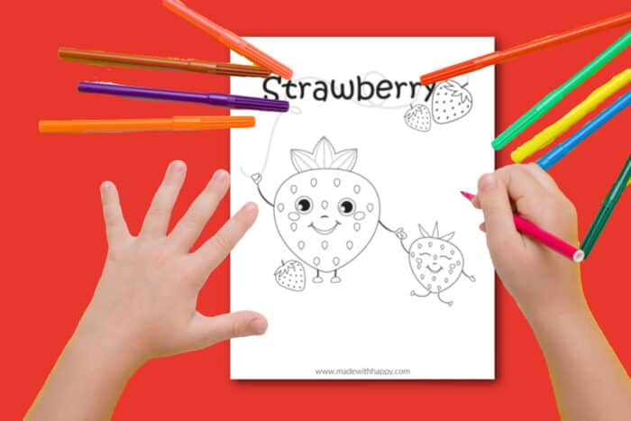 Child Coloring a Strawberry coloring page