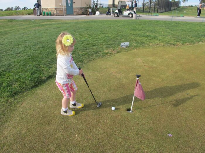 Toddler Girls Golfing. Girls playing sports