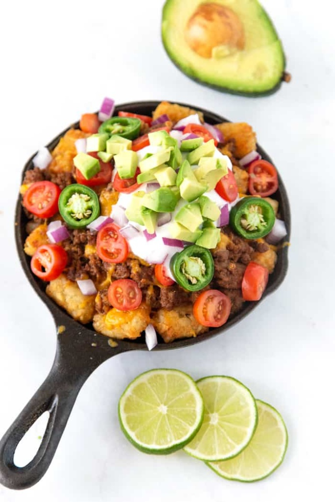 Loaded Totchos. These loaded tater tot nachos recipe is the perfect game day appetizer. We have what is soon to be your favorite totchos recipe loaded with all the fixings.