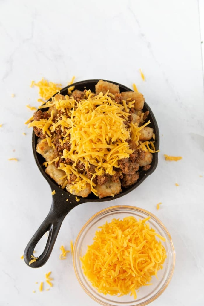 Cheesy Nachos. These loaded tater tot nachos recipe is the perfect game day appetizer. We have what is soon to be your favorite totchos recipe loaded with all the fixings.