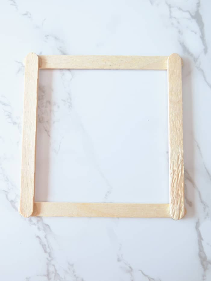 create a frame out of popsicle sticks