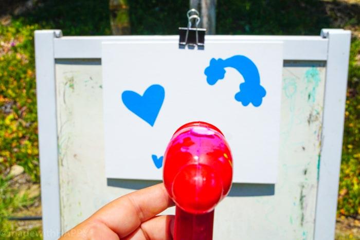 Fun Summer Activities for Kids. Water gun painting. Looking for Summer activities for the kids? The kids LOVE water gun painting throughout the Summer.