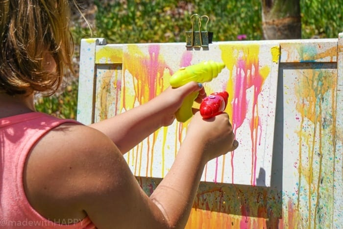 Water Gun Painting in Summer. Water gun painting. Looking for Summer activities for the kids? The kids LOVE water gun painting throughout the Summer.