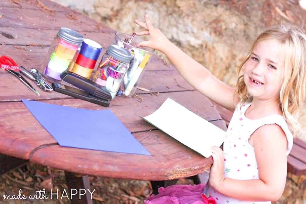 Girl Making Camping Crafts