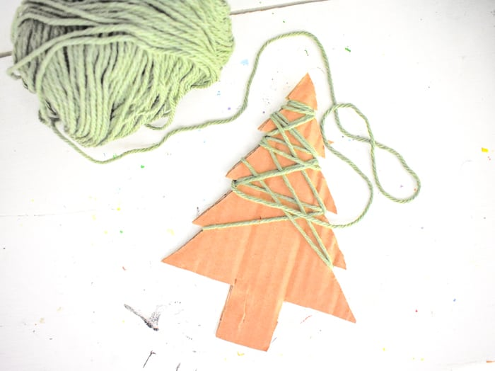 And begin wrapping the yarn around the tree.