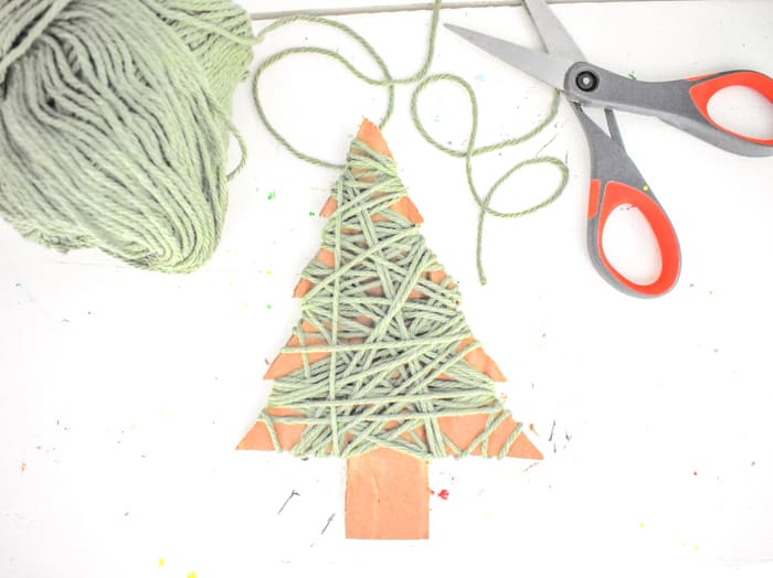 Once wrapped, tape the final end of the yarn to the back of the tree, as well.