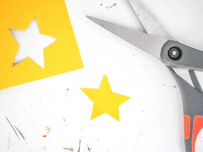 Finally, cut a simple star from the yellow piece of cardstock. You could also use star stickers, instead, for extra ease.