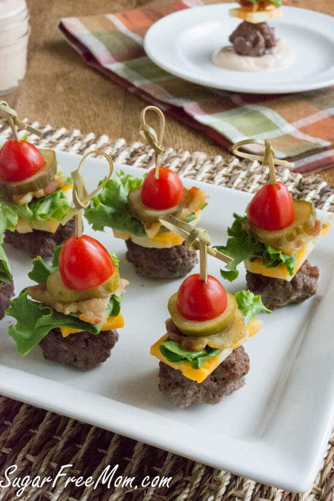 Easy Super Bowl Appetizers - Bunless cheeseburger bites topped with cheese, lettuce, pickles and tomatoes are perfect appetizers for everyone