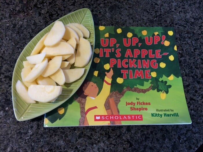 up, up, up! Its Apple Picking Time Book with cut up apples