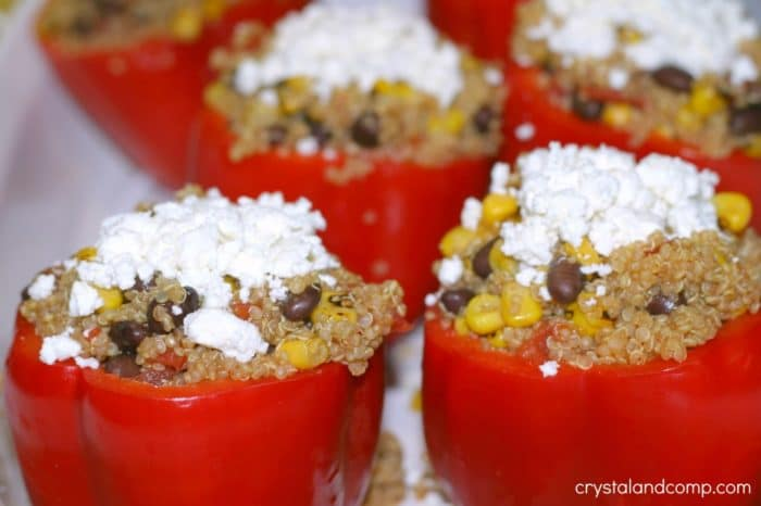 Tex Mex Stuffed Bell Peppers (with Quinoa) - By Chrystal & Co . Super Yummy Veggie Dishes. Vegetable Recipe Ideas. Meatless Monday Recipes.