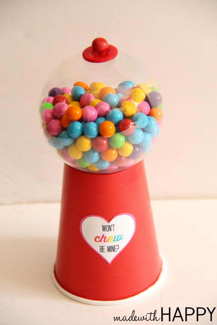 """There are so many fun make your own Valentine option. We are in love with this DIY Gumball Machine with free printable..  We're sharing how to make a gumball machine along with these super cute """"won't chew be mine"""" free printables.  www.madewtihhappy.com"""
