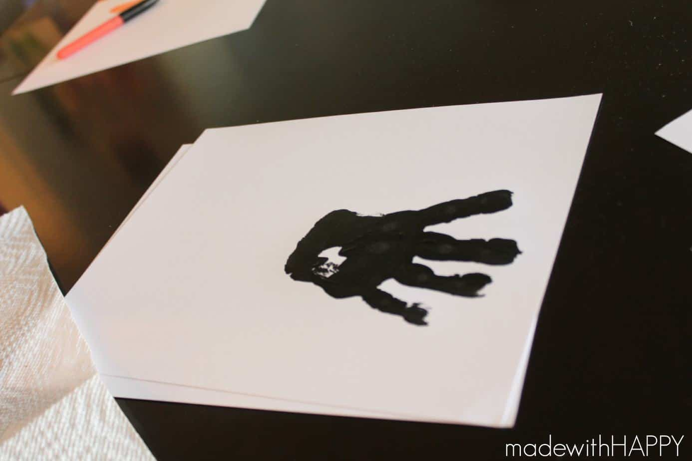 hand print in black paint
