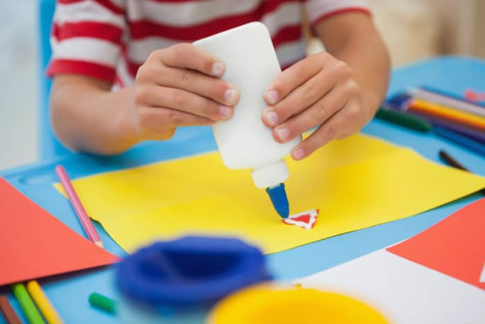 Kid using white glue