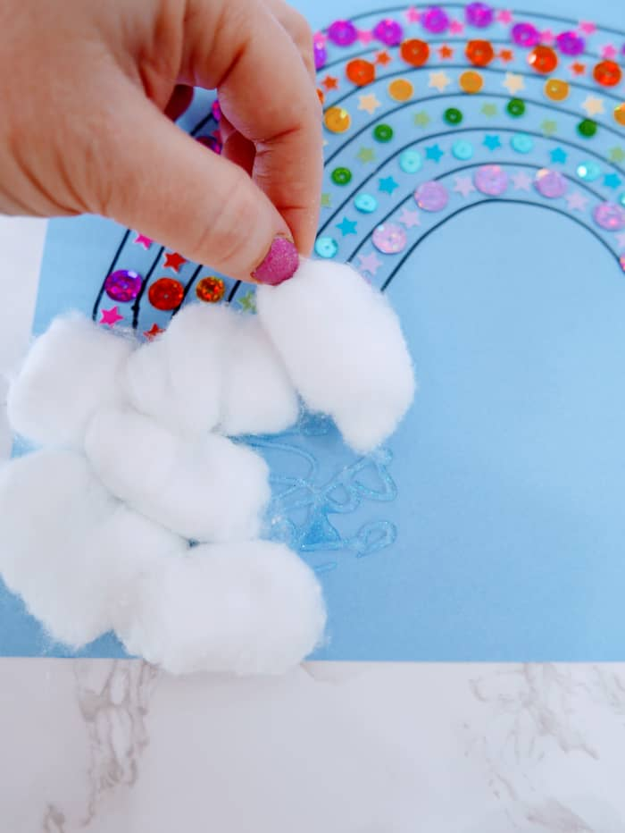 adding cotton balls to end of rainbow craft