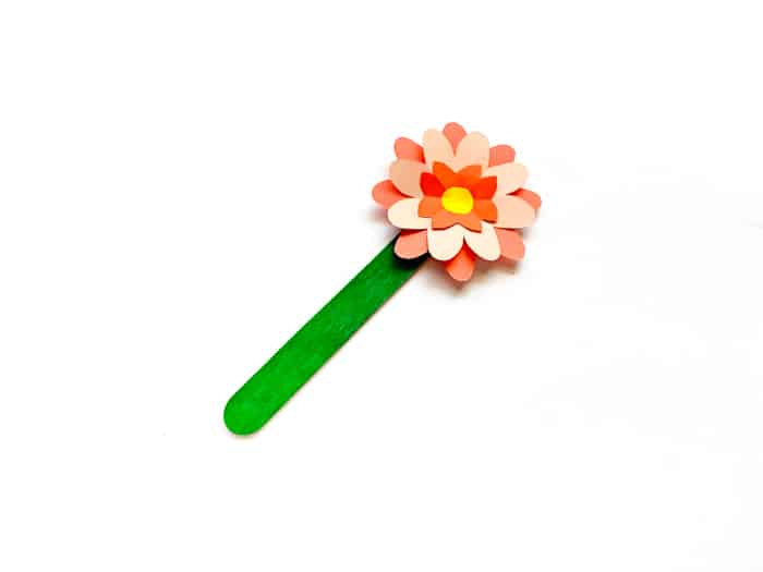 adding paper flower to craft stick
