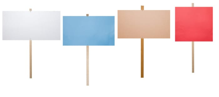 four poster boards on sticks