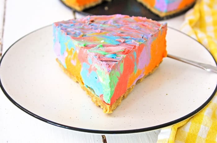 Slice of rainbow cheesecake