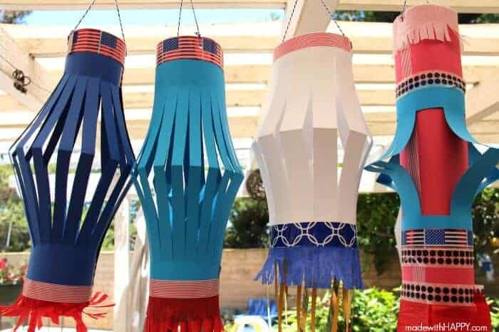 Red, White and Blue Paper Lanterns. Perfect for a 4th of July party. This kids craft is patriotic, fun, festive and easy to make. DIY Paper Lanterns. www.madewithHAPPY.com