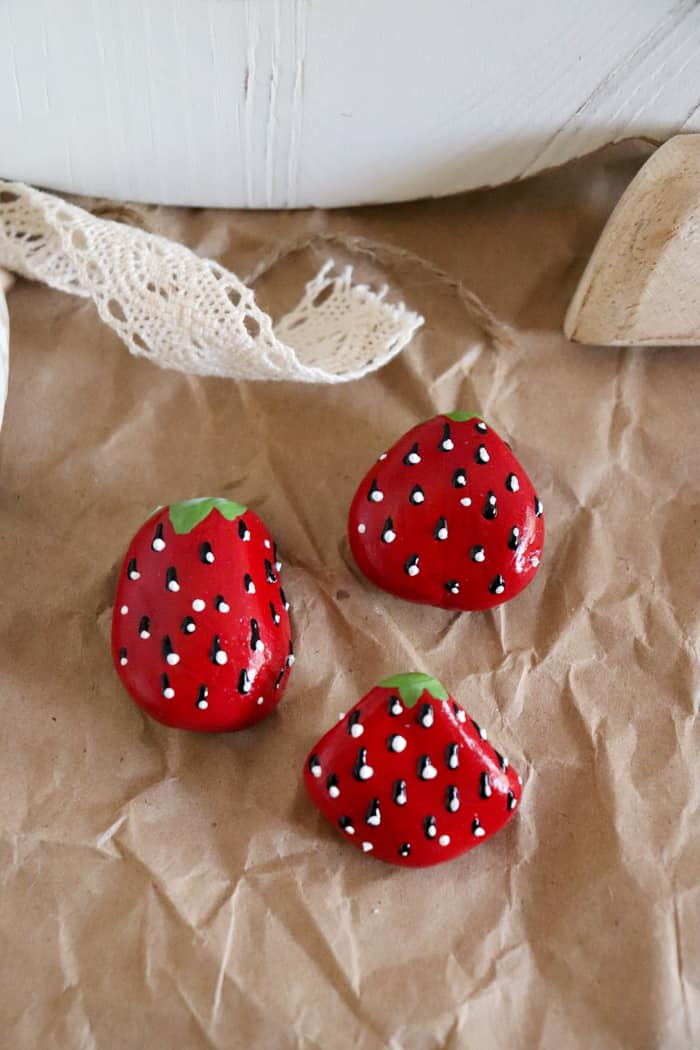 how to paint a strawberry on a rock