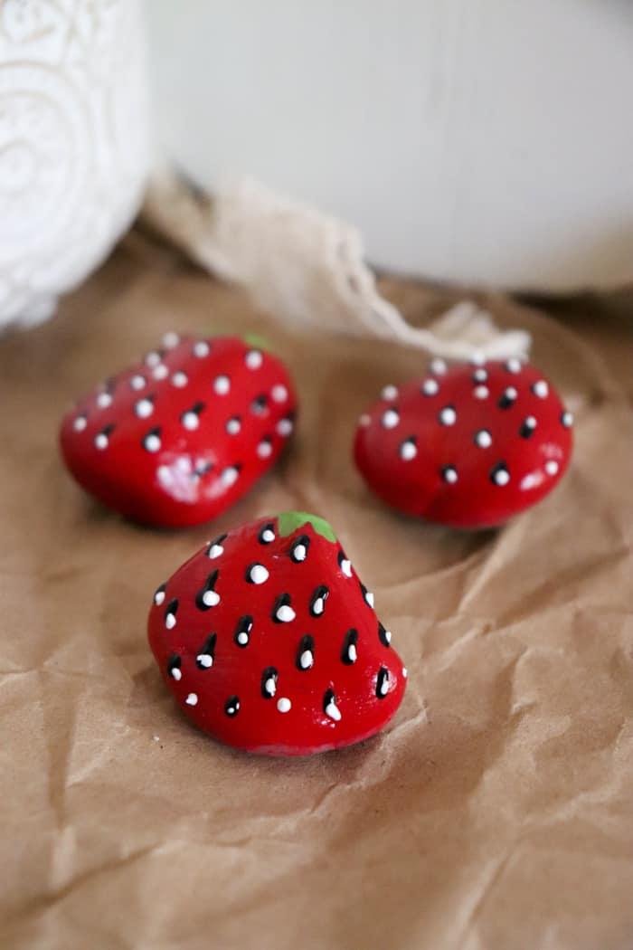 stones painted as strawberries