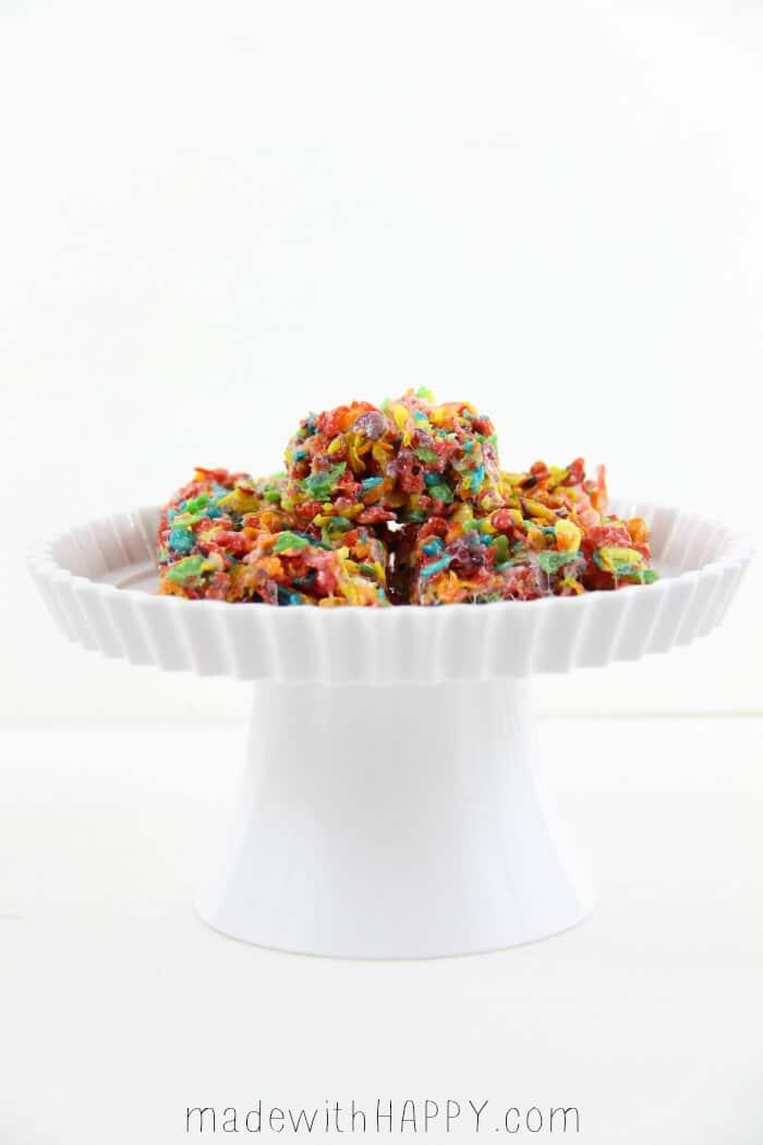 Fruity Pebbles Rice Krispie Treats Recipe - Rainbow Rice Krispie Treats displayed on white dish