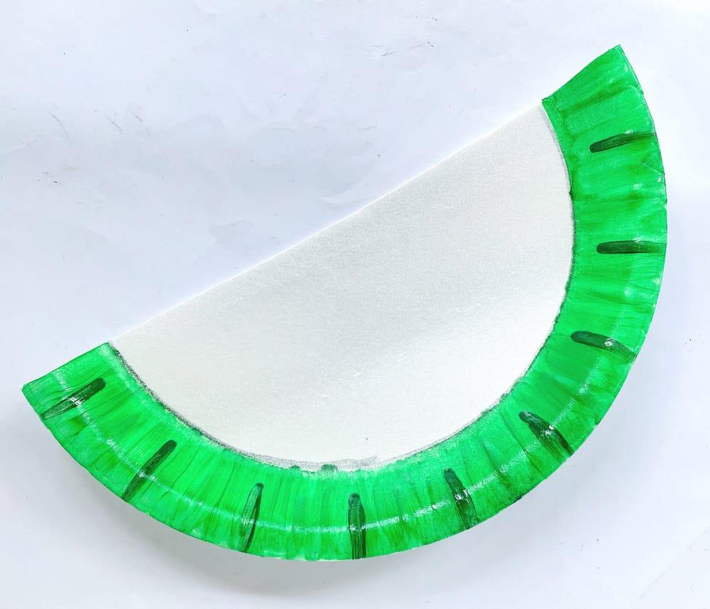draw in line in darker green around edge of paper plate half